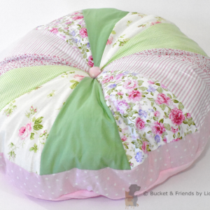 Pouf dog bed. Fluffy and soft. Pink and green.