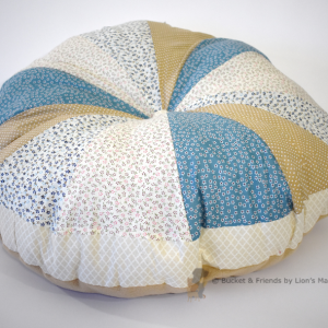 Pouf dog bed. Fluffy and soft. Blue and tan.