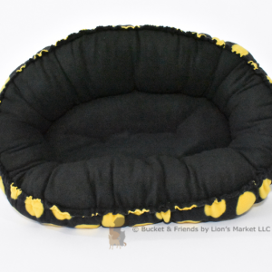 Warm snugly fleece dog cat pet bed. Size small. Black with large yellow polka dots.