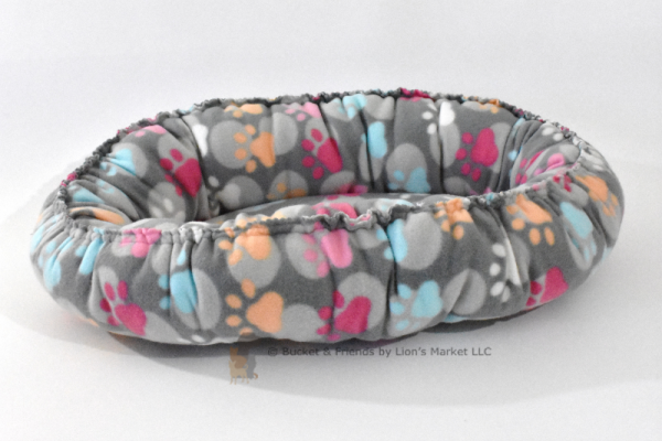 Warm snugly fleece dog cat pet bed. Size small. Gray with pastel paws.