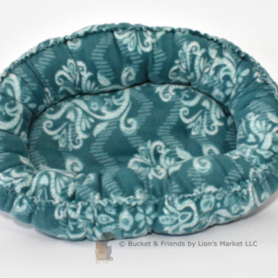 Warm snugly fleece dog cat pet bed. Size small. Teal blue with white design.