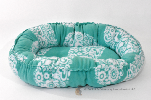 Warm snugly fleece dog cat pet bed. Size small. Teal blue with white hears.