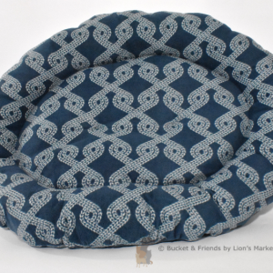 Warm snugly fleece dog bed. Size large. Dark teal blue with tan rope design.