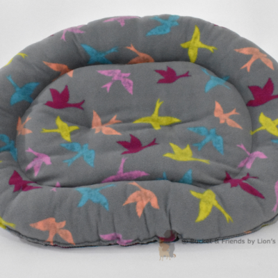 Warm snugly fleece dog bed. Size large. Gray with multi colored birds.