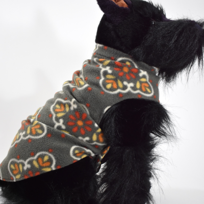 Soft and warm fleece dog coat size medium by bucketandfriends.com. Gray with white orange and yellow design.