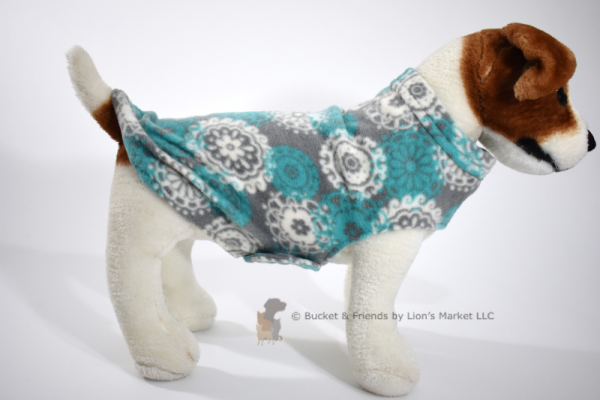 Soft and warm fleece dog coat size small by bucketandfriends.com. Gray with white and teal medallions.