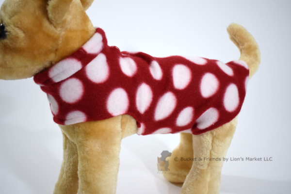 Soft and warm fleece dog coat size extra small by bucketandfriends.com. Red with white polka dots.