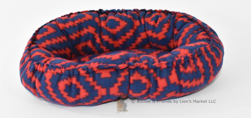 Warm snugly fleece dog cat pet bed. Size Mini. Navy blue and red geometric design.