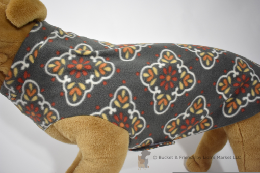 Soft and warm fleece dog coat size extra large by bucketandfriends.com. Gray with yellow orange and white design.