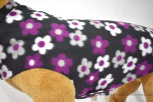 Soft and warm fleece dog coat size extra large by bucketandfriends.com. Black with purple gray and white flowers.